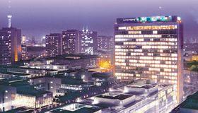 Neuer Schuldschein und neues Geld aus einem Immobilienverkauf bei Axel Springer