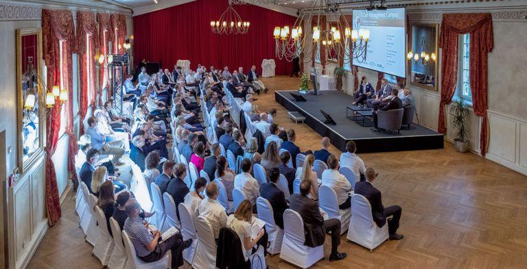 Volles Haus in Köln: Vertreter von Otto, VW, Rewe und BNP Paribas diskutierten über digitale Bezahlmethoden.